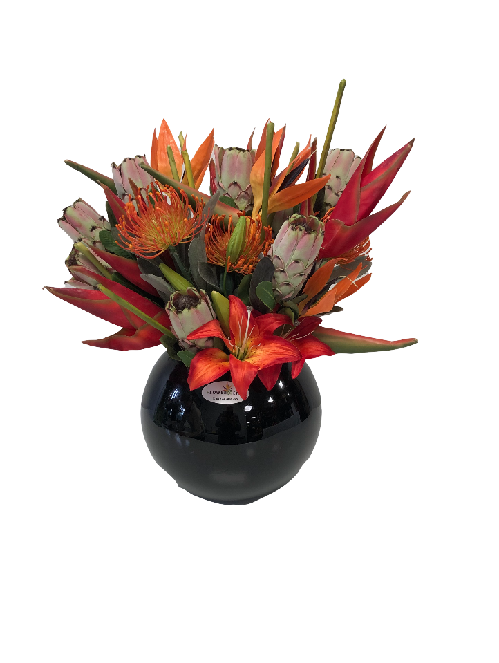 https://www.flower-genie.co.uk/profile/Tropical Mix - Lily / Protea / Helaconia / BOP